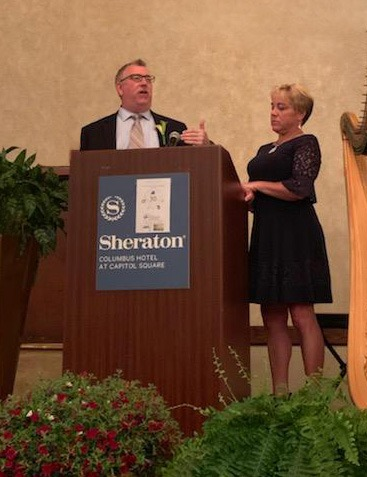 HAWA President Jeff Ortman and his wife Erin speaking at a podium